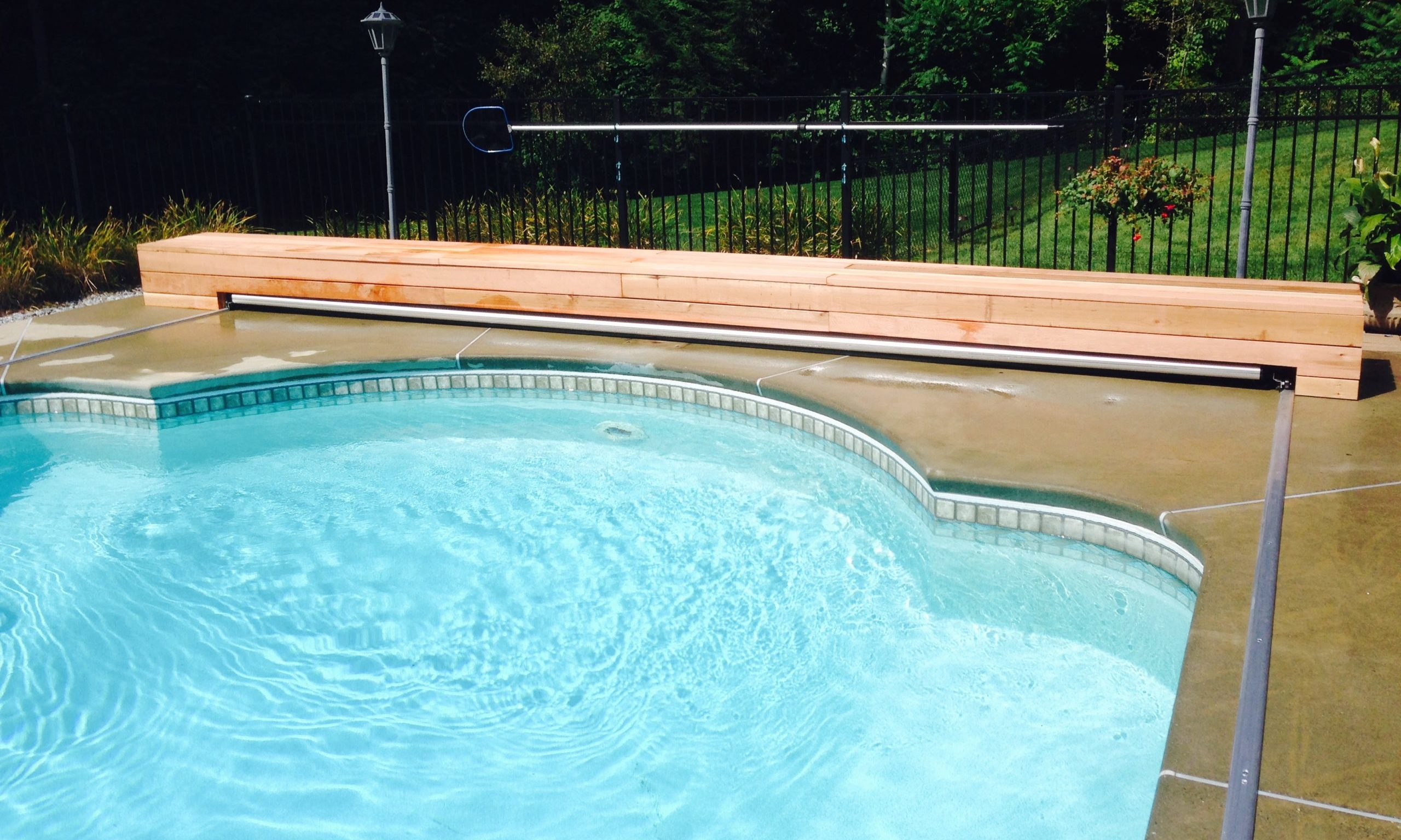Deck mounted and top track automatic pool cover