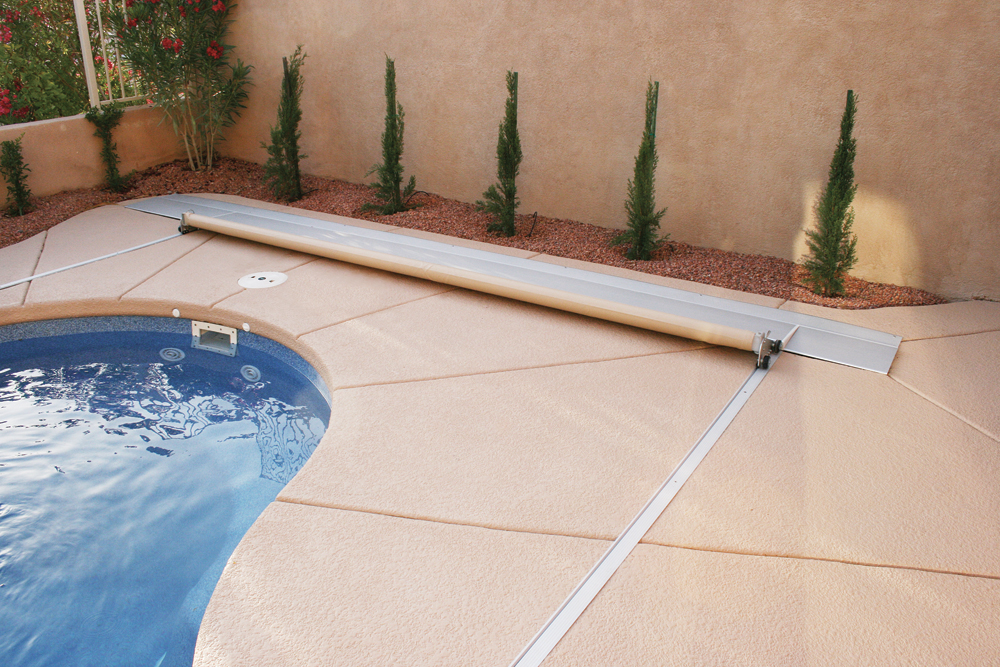 New Pool Cover on an existing pool, freeform pool, top track and recessed mechanism.